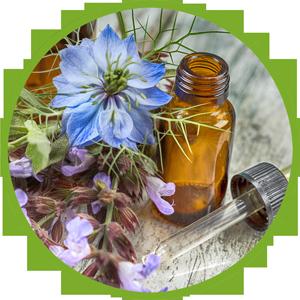 Braunglasfläschen und Blüten
